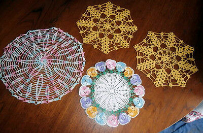 Four crocheted doilies pastel pansies - gold - pinks blues 8 to 10 inch rounds