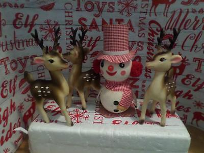Three Rubber Plastic Reindeer Turning Heads with Flocked Vintage Snowman