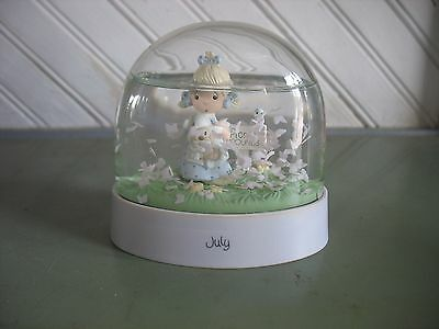 Precious Moments Snow Globe July 1988 & I believe Rugged Cross bud vase 6 1/2""