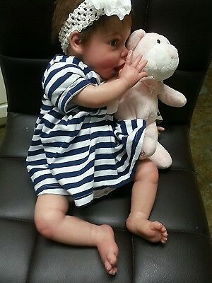 relistic happy reborn baby doll who sucks her thumb