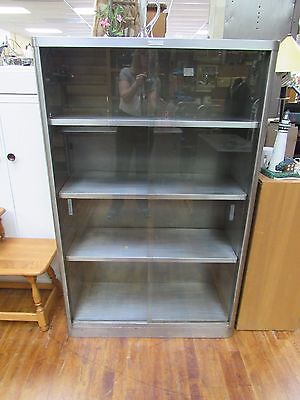 Mid Century Industrial book case with sliding glass doors by McDowell & Craig