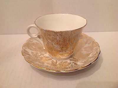 Vintage White Colclough Teacup and Saucer heavily decorated  Floral Guilt/Gold