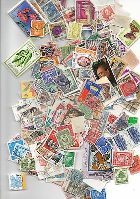20 Grams of charity collected World stamps off paper.
