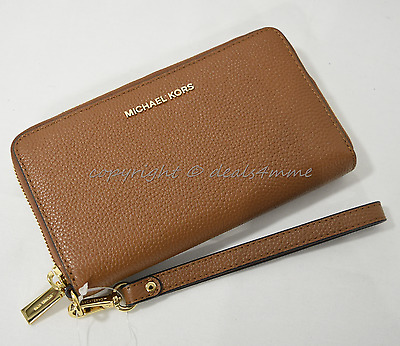 6d062384190c5f Michael Kors Mercer Large Leather Smartphone Wristlet /Wallet in Luggage  Brown