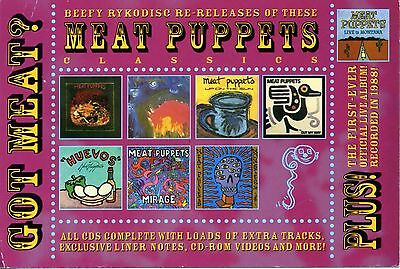 MEAT PUPPETS -  POSTCARD - NICE COLORED FRONT FEATURES ALL ALBUMS TO DATE c 1999
