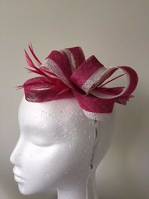 Pink and white sinamay loop fascinator with biot feathers on a metal headband.