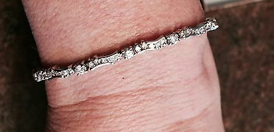 Diamond tennis bracelet 14K white gold scallop 84 round brilliant cut 2.50 carat