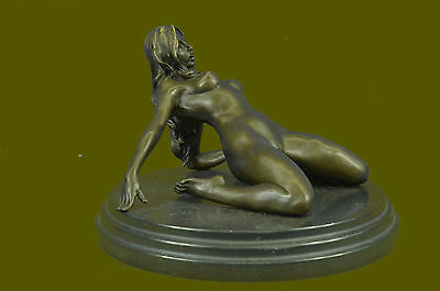 SIGNED: Mavchi BRONZE SCULPTURE NUDE GIRL ON THE HAND FIGURE ABSTRACT MODERN ART