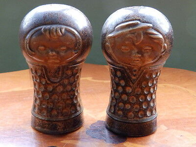 Unusual Art pottery salt and pepper pots in form of a girl and boy