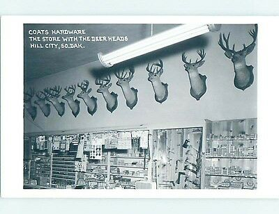 Old rppc TAXIDERMY DEER HEADS AT HARDWARE STORE Hill City South Dakota SD HM4094