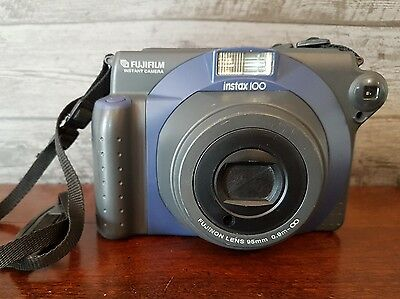 Fujifilm Instax 100 Instant Film Camera With Shoulder Strap In Good Condition