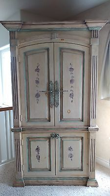 Rustic French Country Armoire With Elegant Detailing. Excellent Condition.