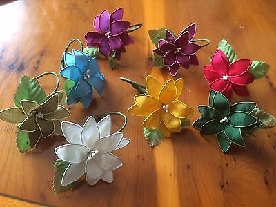 8 different coloured  beautiful Silk Flowers napkin rings