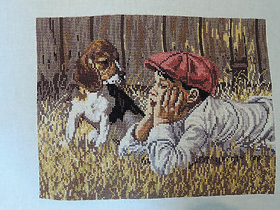 Completed handmade cross stitch picture boy with dog