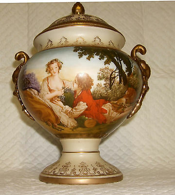 A Continental pottery twin handled vase and cover, Boucher landscape