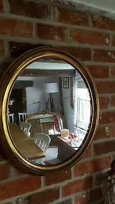 Edwardian brass framed oval mirror