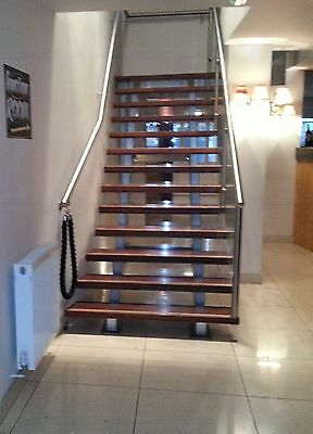 Italian style stainless steel and glass floating staircase
