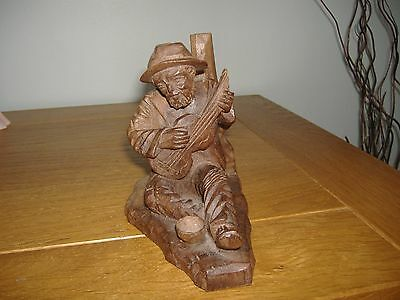 Black Forest Carved Wooden Figure of Man Sitting down Playing Guitar