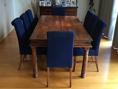Beautiful Wooden Dining Table With 8 Blue Fabric Roll Top Chairs