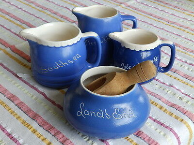4 pieces of Devon Ware, blue and white jugs and bowl