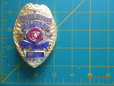 1  badge MILITARY POLICE  DEP OF THE NAVY US MARINE CORPS