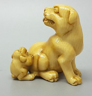 A Netsuke of a Lioness and her Cub, signed, Early 20th century
