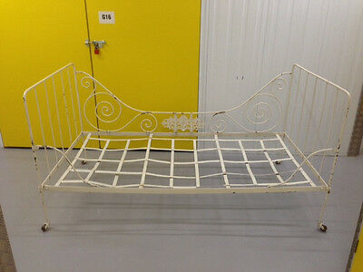 Antique French Iron Day Bed. Cream painted, nicely distressed. Foldable.