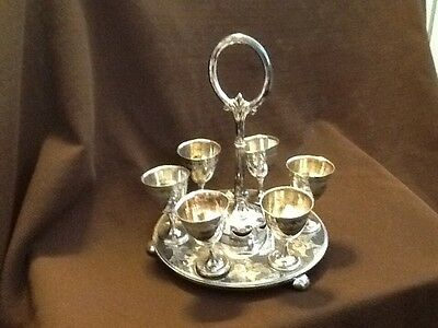 Antique Footed Egg Cup holder with six Egg Cups