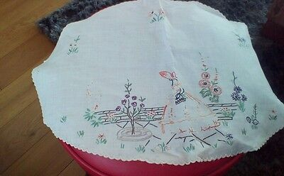 Vintage hand embroidered dressing table cover.
