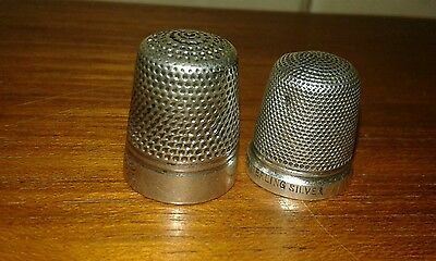Two silver thimbles