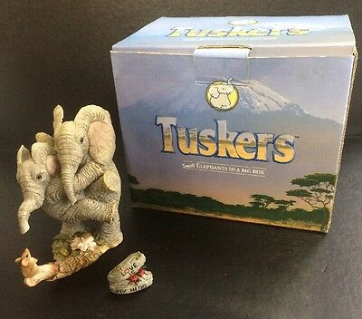"Tuskers model 90856 ""Love is my hero "" figurine ornamental elephants"