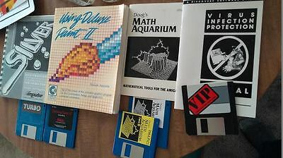 Old Amiga computer software floppy disks with manuals