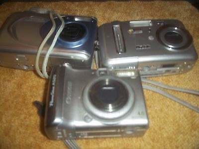 LOT OF 3 digital cameras for parts (CANON KODAK AND NIKON)