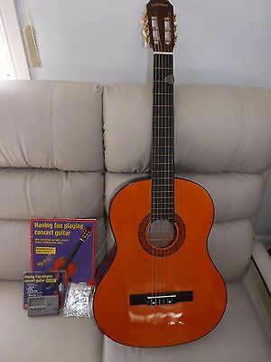 Acoustic Guitar  with book, cd ,case and tuner.