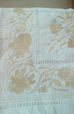 Vintage hand embroidered tablecloth in gold.