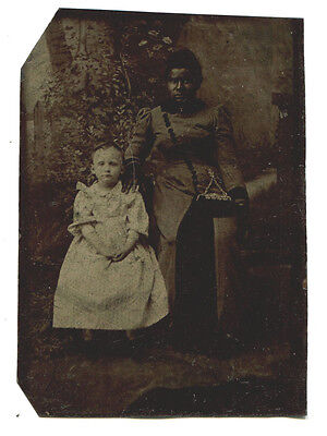 African American Woman With White Child. Affectionate Pose. Tintype.