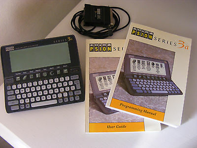 Working PSION Series 3a Palmtop Handheld Computer 1993, with books and lead.
