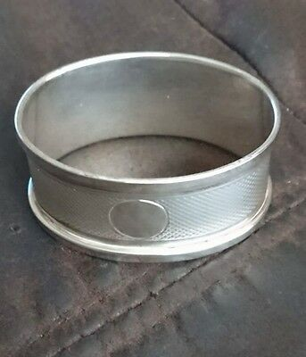 Sterling silver engine turned oval napkin ring