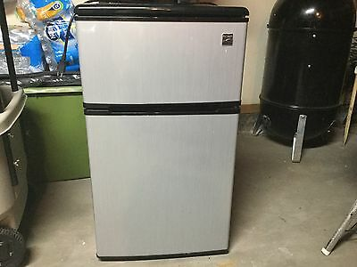 dorm size refridgerator. Kenmore. Black and stainless steel. Slightly used.