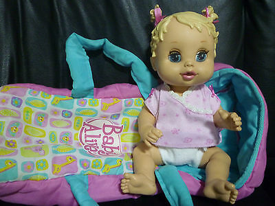 Baby Alive Doll & her doll Carrier