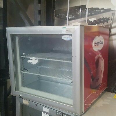 Tefcold UF50G Glass Door Display Freezer With Haagen Dazs on sides.