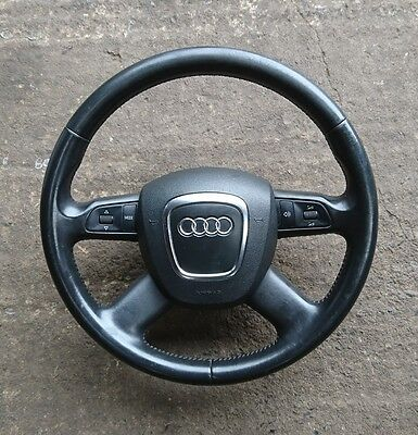 Audi A6 C6 A4 B7 black leather 4 spoke steering wheel with controls and airbag