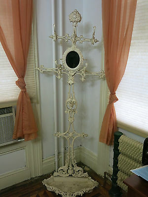 Antique cast iron tall halltree stand very ornate with oval mirror late 1800's