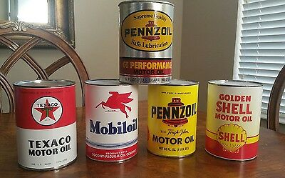 Used 4 reproduction oil cans One Authentic cardboard Pennzoil can, Display use.