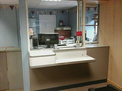 Post Office Fortress counter with security door and parcel hatch