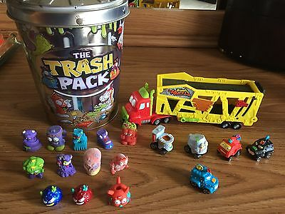 The TRASH PACK TRASH WHEELS MUCK MOVER and TRASHIES LOT GARBAGE CAN MOOSE TOYS