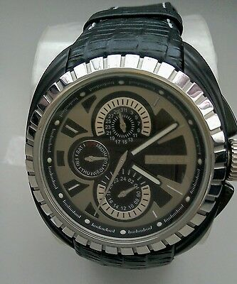 mans wrist watch by Police
