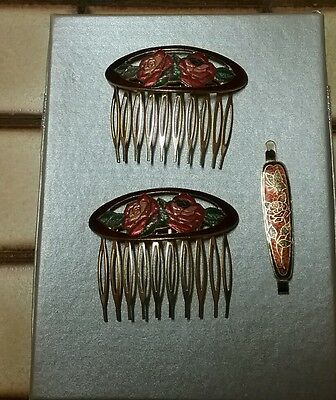 Vintage hair combs (two)and matching hair clip.Floral design.Like new