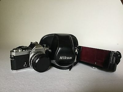 NIKON FM 35mm SLR with 50 F1 - 8 lens  with original fitted leather case.