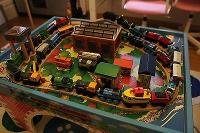 Wooden Thomas the Tank Engine train set and table.